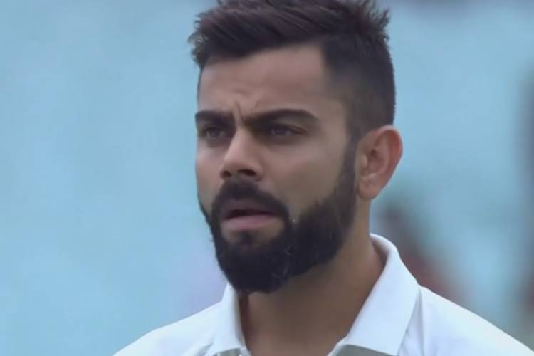 Virat Kohli does a Parvez Rasool, caught-on-cam chewing gum during National Anthem — WATCH