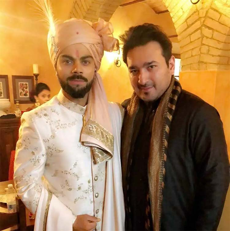 Virat Kohli with a friend on his wedding day