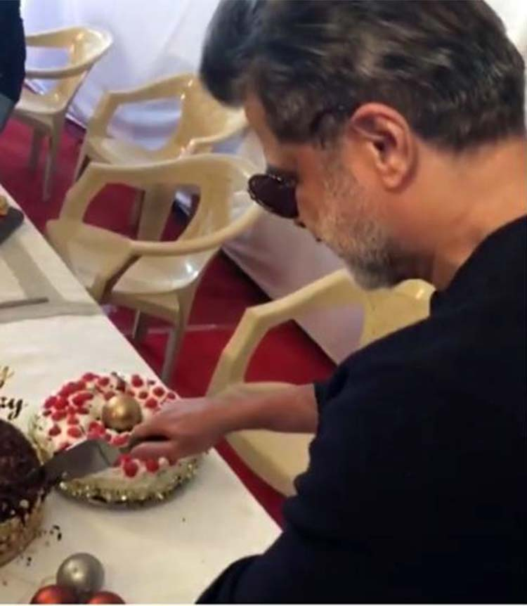 Anil Kapoor cutting his birthday cake on sets of Race 3