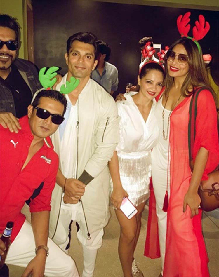 Karan Singh Grover and Bipasha Basu with their friends at a Christmas party