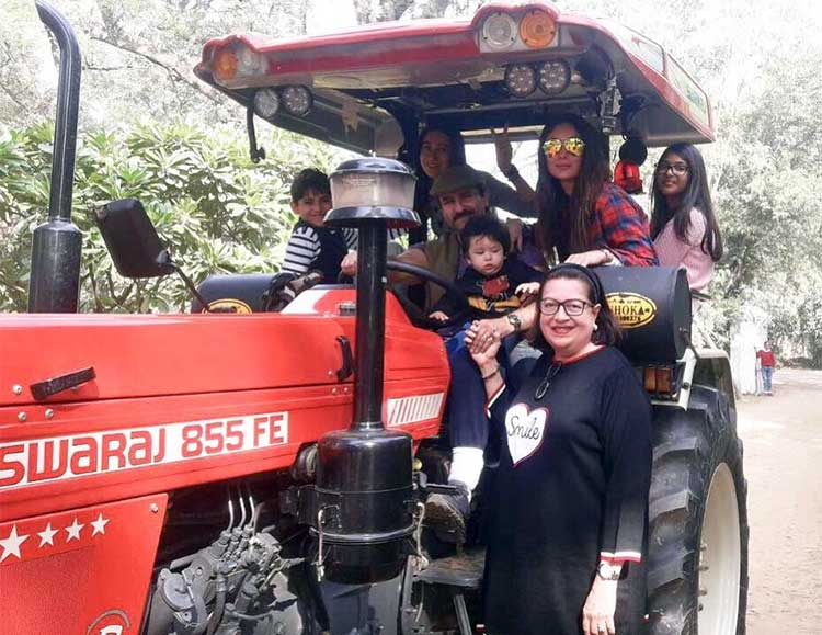 Taimur enjoying a tractor ride with his family prior to birthday celebrations