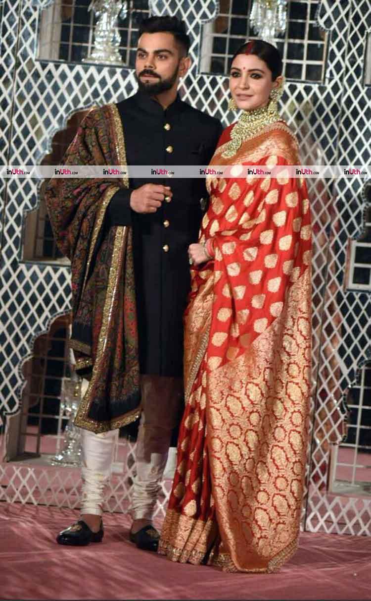 Virat Kohli and Anushka Sharma arriving at the Delhi wedding reception