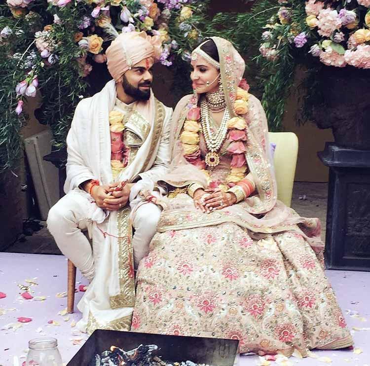 Virat Kohli and Anushka Sharma caught candid at their wedding