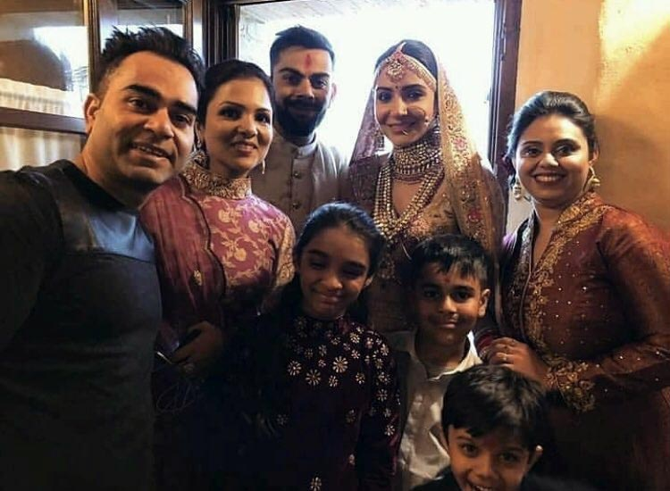 Virat Kohli and Anushka Sharma with family at their wedding