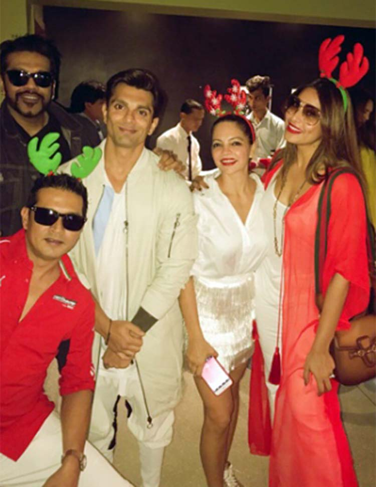 Bipasha Basu and Karan Singh Grover twinning in white for Christmas party