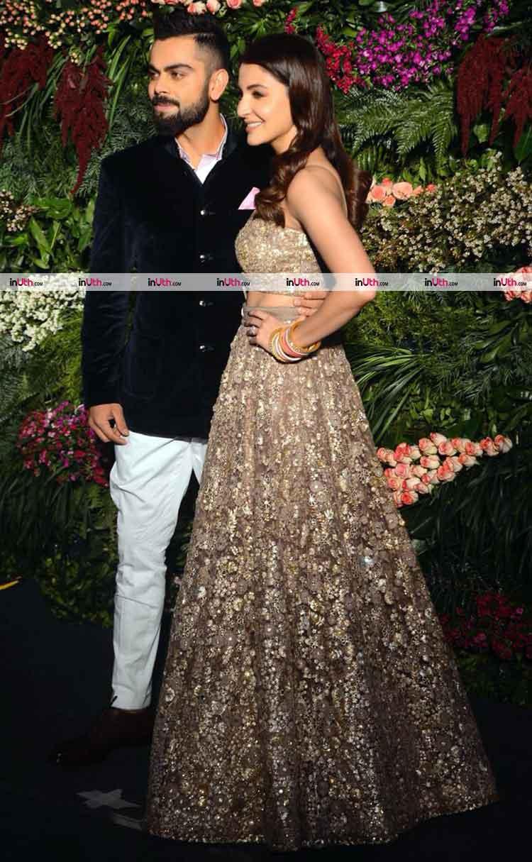 Virat Kohli and Anushka Sharma snapped at their wedding reception in Mumbai