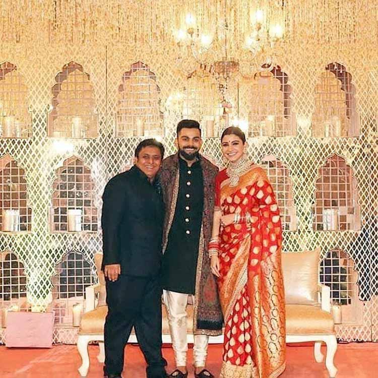 Virat Kohli and Anushka Sharma with a friend at their Delhi reception party