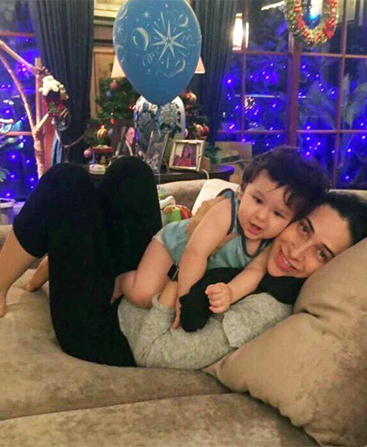Taimur celebrating his first birthday with masi Karisma Kapoor