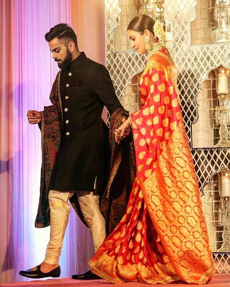 Virat Kohli with Anushka Sharma at the wedding reception party in Delhi