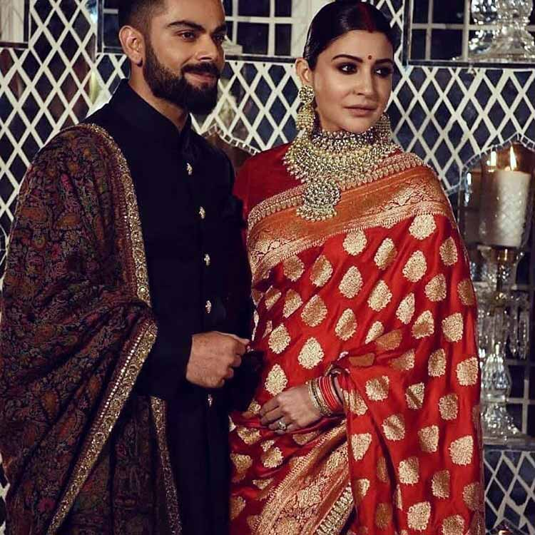 Virat Kohli and Anushka Sharma slaying at their wedding reception in Delhi