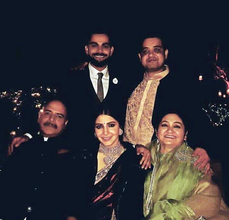 Virat Kohli and Anushka Sharma with the latter's family on their engagement