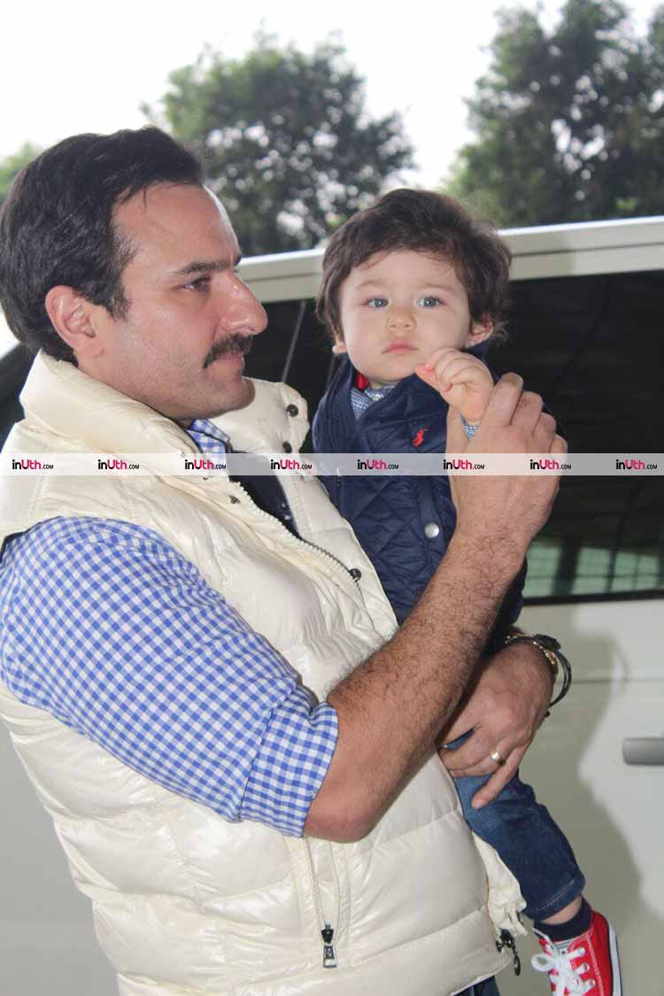 Saif Ali Khan making Taimur wave to the cameras