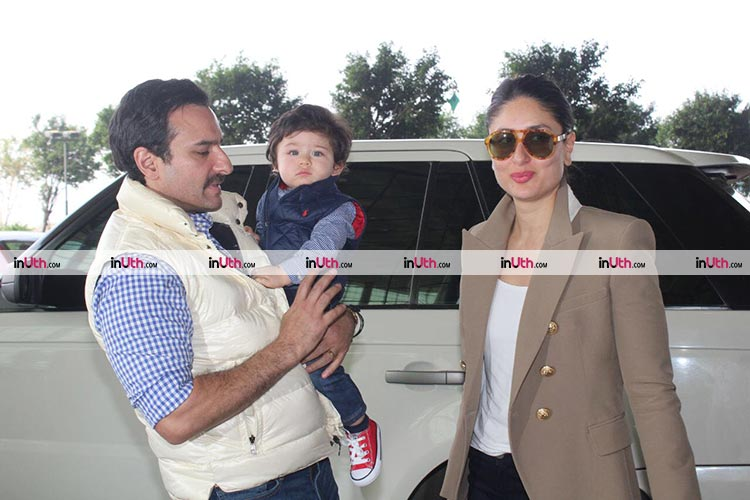 Saif Ali Khan, Kareena Kapoor, and Taimur posing for the camera
