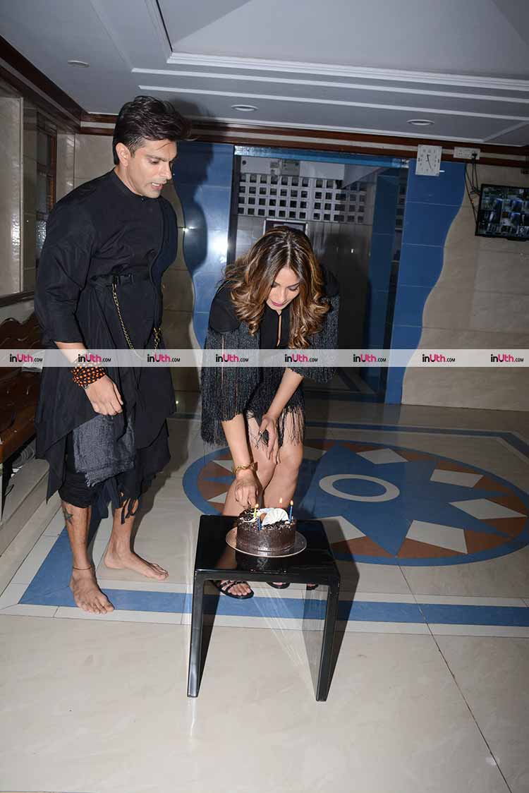 Bipasha Basu cutting her birthday cake in presence of the media