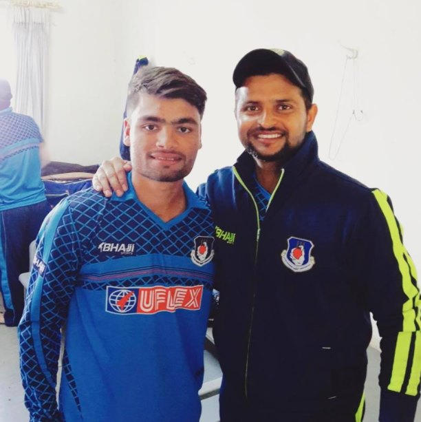 With his idol Suresh Raina