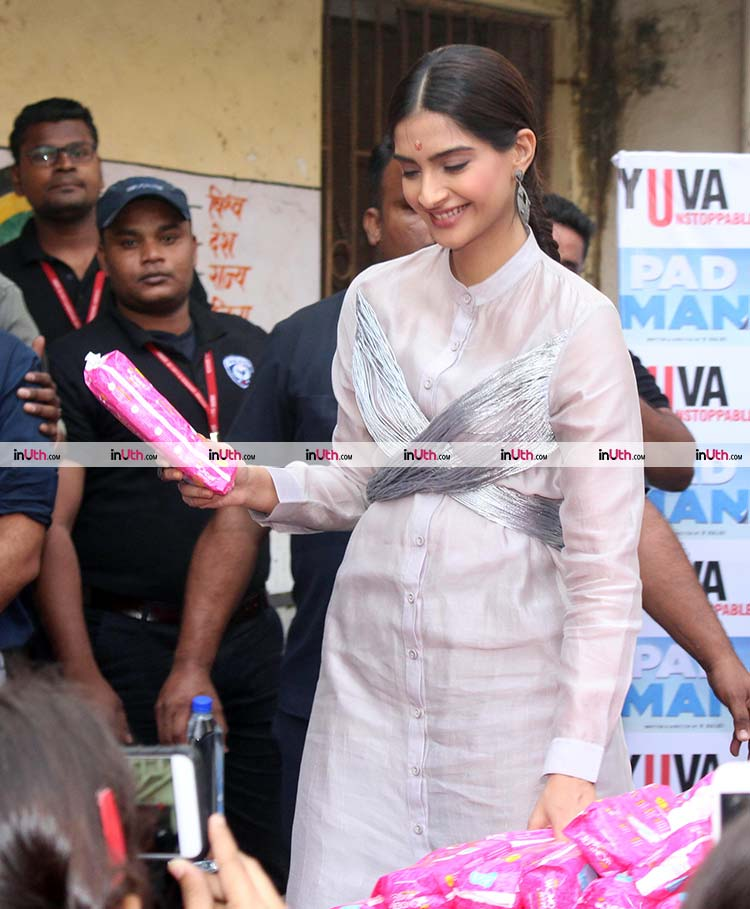Sonam Kapoor distributing sanitary pads in a school of PadMan promotions
