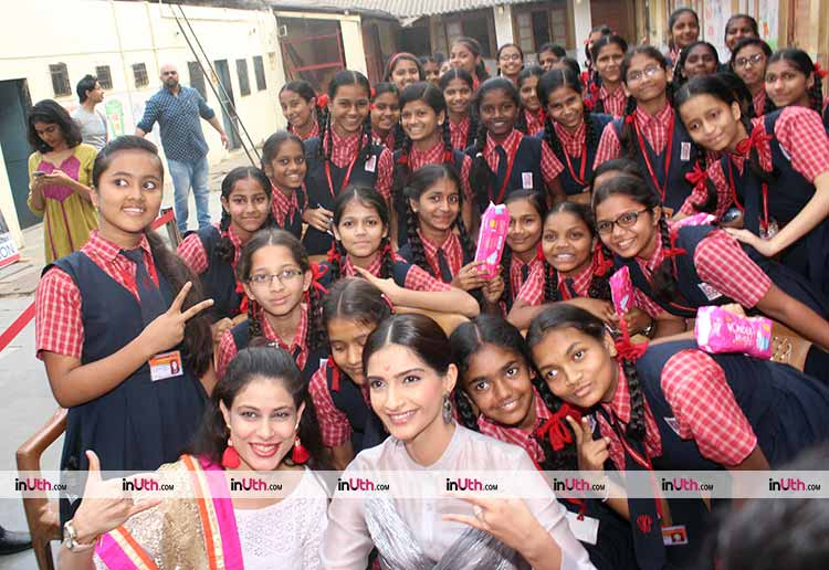 Sonam Kapoor posing with the school girls during PadMan promotions