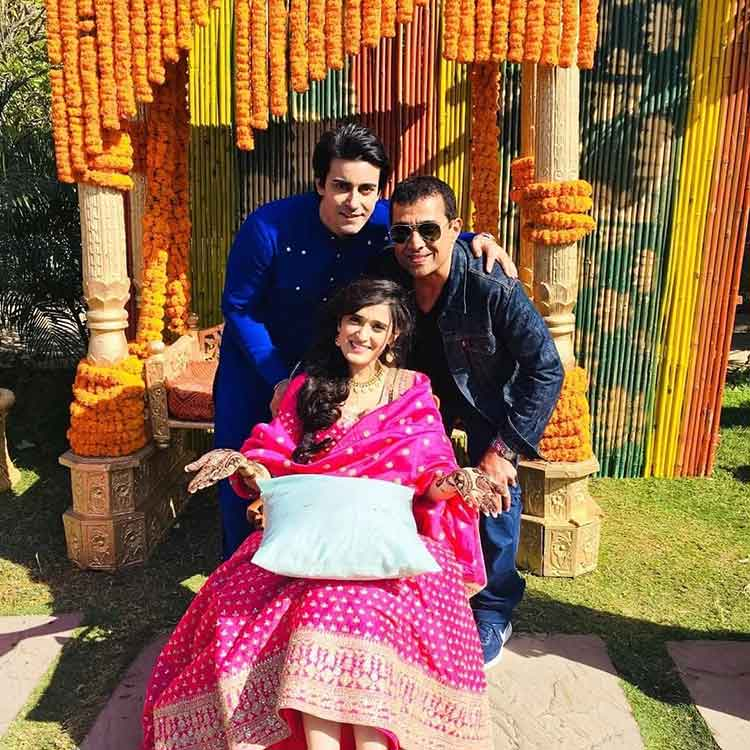 Gautam Rode and Pankhuri Awasthy with a friend at their mehendi ceremony