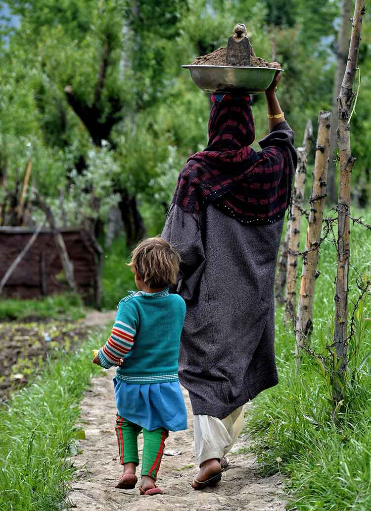A woman in Budgam district of Kashmir with her child
