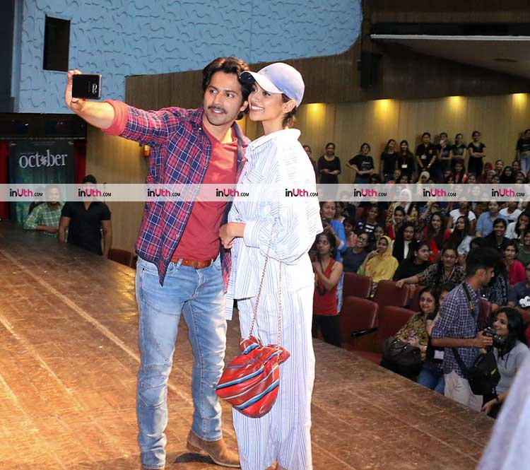Varun Dhawan and Banita Sandhu clicking a selfie while promoting October