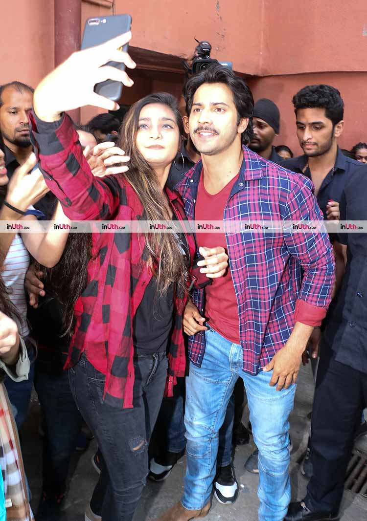 Varun Dhawan with a fan in Mumbai during October promotions