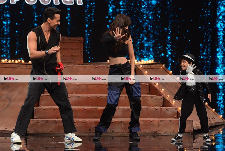 Tiger Shroff and Disha Patani performing with a little kid during Baaghi 2 promotions