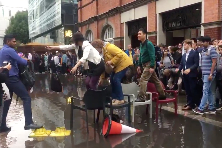 Londoners Building A Bridge Over A Puddle Is The Most British Thing Ever