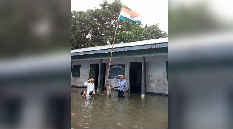 Why This Pic Of Flooded Assam School Hoisting Tricolour Has Come To Haunt A 9-Year-OldBoy