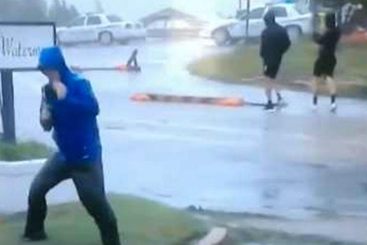 #GoofUp: Weatherman 'Battles' Winds While People Casually Stroll By